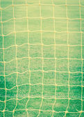 Goal net with green football field vintage — Stock Photo