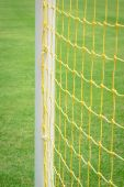 Goal net with green football field — Stock Photo
