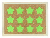 Green stars on cork notice board — Stock Photo