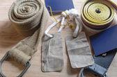 Set of fabric belt and label on wood background — Stock Photo