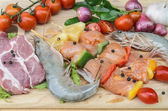 Fresh meat ,seafood  and vegetables on kitchen board  — 图库照片