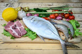Fresh meat ,seafood  and vegetables on kitchen board  — Stock Photo