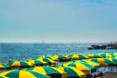 Colorful umbrella at the sea — Stockfoto