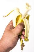 Holding a real peeld banana — Stock Photo