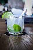 Mojito cocktail in a restaurant on a rustic wooden table — Stock Photo