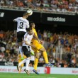 Valencia CF and Malaga CF players in action — Stock Photo #52318937