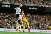Valencia CF and Malaga CF players in action — Stock Photo