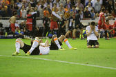 Valencia players on the floor after Sevilla goal — Стоковое фото