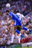 Didier Drogba (L) and Raul Albiol (R) in action — Fotografia Stock