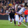 Antonio Tomas (L) and David Villa (R) in action — Stock Photo #54471557