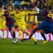 David Fuster (C), Yaya Toure (R) and Xavi (L) in action — Stock Photo #54473909