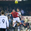 Постер, плакат: Walter Gerardo Pandiani L and Ricardo Costa R fighting for a ball