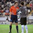 Постер, плакат: Referee Felix Brych L and goalkeeper Cesar Sanchez R during the game