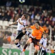 Mustafa Keceli (R) and Juan Manuel Mata (L) fighting for a ball — Stock Photo #57378059