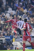 Joao Victor (L) and Aritz Aduriz (R) in action — Stock Photo