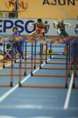 Dongpeng Shi of China compete in the Mens 60 Metres Hurdles Heat — Zdjęcie stockowe