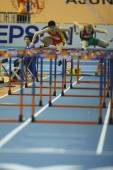 Dongpeng Shi of China compete in the Mens 60 Metres Hurdles Heat — Stock fotografie