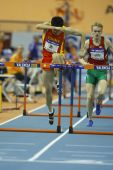 Dongpeng Shi of China compete in the Mens 60 Metres Hurdles Heat — Stockfoto
