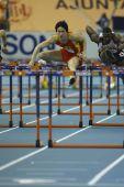 Liu Xiang of China compete in Semifinal of the Mens 60 Metres Hurdles Heat — Foto Stock