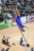 Renaud Lavillenie competes in the Men's pole vault — Stock Photo