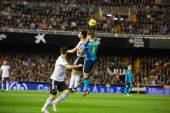 Carrico of Sevilla jumping for the ball and Negredo (L) — Fotografia Stock