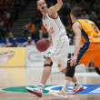 Постер, плакат: Mantas Kalnietis with a ball and Nemanja Nedovic