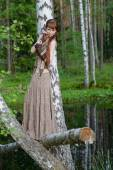 Young beautiful girl in the forest — Stock Photo