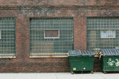 Old building and street litter bins — Stock Photo