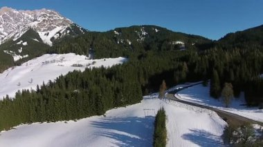 Ski resort, winter sun snow and mountains in the austrian alps. aerial view. — Stock Video