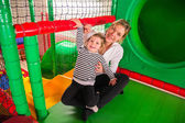 Mom and daughter in indoor playroom — Stock Photo