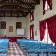 Conference hall in ancient villa with canvas blue chairs and red — Stock Photo #75243983