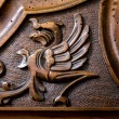 Phoenix figure carved in the wood — Stock Photo #76995579