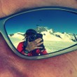 Photographer reflected on sunglasses while climbing Mönch mountain in the Alps, Switzerland — Stock Photo #52411073