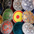 Traditional colorful Moroccan faience pottery dishes in a typical ancient shop in the Medina's souk of Marrakech, Morocco. — Stock Photo #52411211