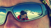 Photographer reflected on sunglasses while climbing Mönch mountain in the Alps, Switzerland — Stock Photo