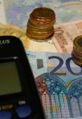 Closeup of calculator on european notes and coins background — Stock Photo