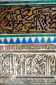 Moroccan Zellige Tile Pattern and Carved Plaster Arabesque arch of the 14th century El Attarine Medersa in Fez, Morocco — Stock Photo