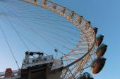 London Eye in Waterloo, London  - February 15th of 2015: This is the third largest ferris wheel all around the world. This tourist attraction is 135 meters tall with a diameter of 120 metres. — Stock Photo