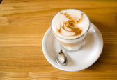 Glass coffe mug on wooden table — Stock Photo