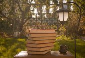 A stack of books and a garden lantern — Stock Photo