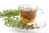 Thyme tea with bunch of fresh thyme beside, served on white background, isolated — Stock Photo