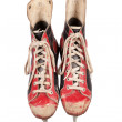 Old and used ice skates, red and black colored, white background, isolated, retro, vintage — Stock Photo