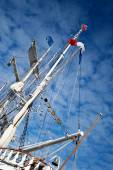 Mast of a yacht with a french flag on top, with view to blue heaven, harbor of marseille, france — Stock Photo