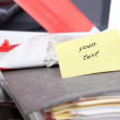 Blank post-it on document file, monitor wrapped in barrier tape, bureau, secretarial, protesting workers, — Stock Photo #53722317