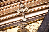 Crucifix on sides of ancient bible, — Stock Photo