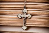 Jesus crucifix on sides of old bible, — Stock Photo