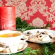 Christmas tea, cookies and red candle in front of vintage wallpaper — Stock Photo #58722415