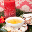 Christmas decoration with herbal tea, red candle and homemade christmas cookies, — Stock Photo #59032327