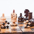 Chess Game with winning white King, surrounded by fallen queens, white background, copy space — Stock Photo #61356285