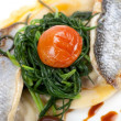 Gourmet fish dinner with mediterranean sea bass fillet, green vegetables and ravioli — Stock Photo #70121851